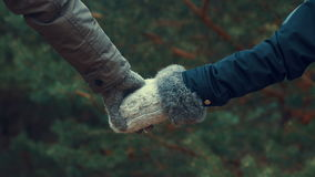 Lovers holding hands, close up stock footage