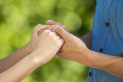 Lovers holding hands outdoors Stock Image