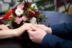 Lovers holding hands on the table Royalty Free Stock Photo