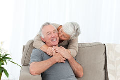 Lovers hugging in the couch Stock Photo