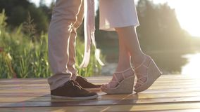 Lovers hugging on the pier in the summer evening stock video footage