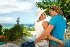 Lovers hugging in tropical resort. Lovers hugging and looking each other in tropical resort Stock Photos