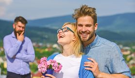 Lovers hugs outdoor flirt romance relations. Couple romantic date lovers bouquet flowers. Infidelity concept. Couple in. Love dating while jealous bearded man royalty free stock photography