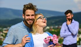 Lovers hugs outdoor flirt romance relations. Couple romantic date lovers bouquet flowers. Infidelity concept. Couple in. Love dating while jealous bearded man royalty free stock images