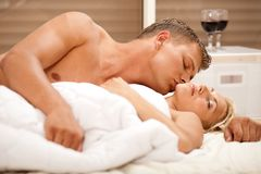 Lovers kissing in bedroom Stock Photography