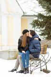 Lovers kissing on the bench Royalty Free Stock Images