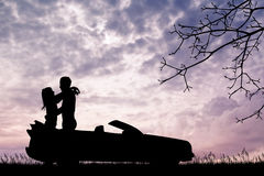 Lovers kissing on car Royalty Free Stock Photos
