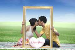 Lovers kissing in the park Royalty Free Stock Images