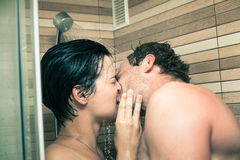 Lovers kissing in shower Royalty Free Stock Photo
