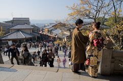Couple in Kyoto`s crowded center, Japan