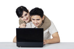 Lovers with laptop isolated over white Royalty Free Stock Image