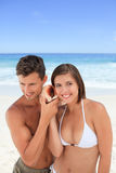 Lovers listening to their shell Stock Photo