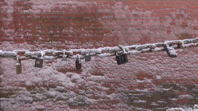 Lovers lock on bridge chain in winter Stock Images