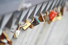 Lovers locks locked on a bridge. Outdoor Royalty Free Stock Photo
