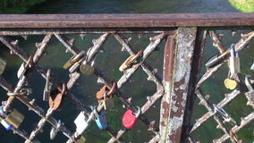 Lovers locks on  river bridge rail stock footage