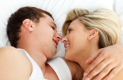 Lovers looking each other in bed Royalty Free Stock Images