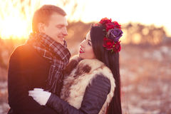 Lovers looking on each other. Cheerfull young lovers are smiling and hugging in sunlight Stock Photos