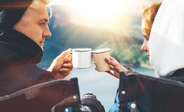 Lovers looking at each other, couple enjoy together of sun flare mountain, travelers drink tea on cup enjoy nature, romantic look. On background of panoramic royalty free stock photos