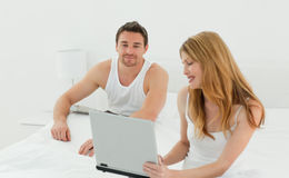 Lovers looking at the laptop Stock Photos
