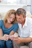 Lovers looking at a pregnancy test Stock Image