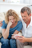 Lovers looking at a pregnancy test Stock Images