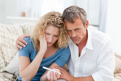 Lovers looking at a pregnancy test Royalty Free Stock Photography