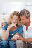 Lovers looking at a pregnancy test Stock Photography