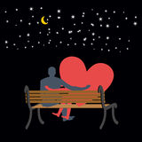 Lovers looking at stars. Date night. Man and love sitting on ben Stock Image