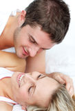 Lovers lying in bed Stock Photography