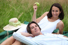 Lovers lying in grass Stock Image