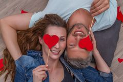 Lovers lying on ground. Valentine celebrating couple at home stock photos