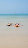 Lovers lying in the landwash on a bounty beach. Thong Nai Pan Yai, Koh Pangan, Thailand, April 26, 2016 , Couple lying in the landwash on a bounty beach Royalty Free Stock Photography