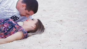 Lovers lying on the sand near the sea - love story.  stock video