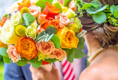 Lovers - man ans woman- holding colorful flower bouqet Stock Photography