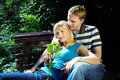 Lovers man and woman. In sun garden Stock Image