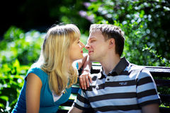 Lovers man and woman. In sun garden Stock Photos