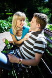 Lovers man and woman. In sun garden Stock Photography