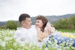 Lovers meet men and women on a beautiful flower field. Stock Photo