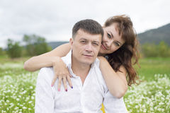 Lovers meet men and women on a beautiful flower field. Lovers men and women on a beautiful flower field. A romantic date Royalty Free Stock Photo