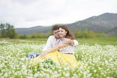 Lovers meet men and women on a beautiful flower field. Stock Photography