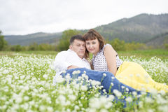 Lovers meet men and women on a beautiful flower field. Lovers men and women on a beautiful flower field. A romantic date Royalty Free Stock Image