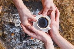 Lovers of men make coffee on the fire in the Turk stock photos