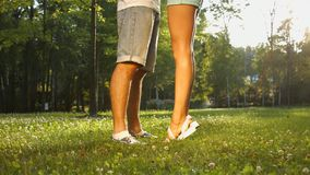 Lovers met in the park. A date of lovers. A romantic date in the night park. Beautiful legs of lovers stock video footage