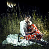 Lovers in the moonlight picnic. Beautiful young lovers in the moonlight picnic stock photography