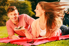 Lovers with muffins outdoor Stock Photography