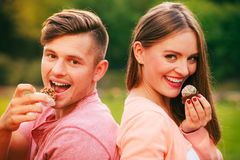 Lovers with muffins outdoor Royalty Free Stock Photo