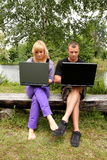 Lovers, nature and computer addiction Stock Image