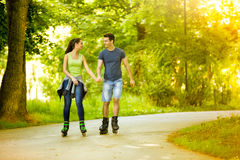 Lovers in nature on rollerblades Royalty Free Stock Photo