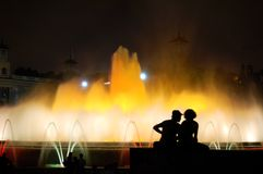 Lovers nex to fountain stock photography