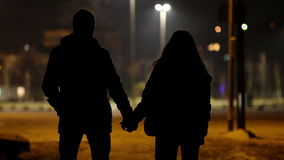 Lovers at night Stock Images